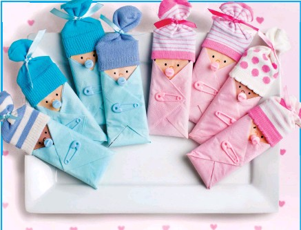 Pressreader womans world 2018 03 12 make sweet baby shower the top of the candy bar into the baby sock and tie with ribbon as shown repeat steps for each candy bar favor negle Images