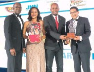 Pressreader jamaica gleaner 2017 05 23 another best for grantley stephenson right being presented with an award by deane shepherd managing director blueprint consulting looking on are kwl executives mark malvernweather Images